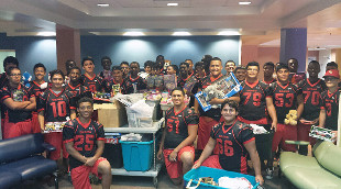 WO Football Team presented Toys & Books to Driscoll Children's Hospital
