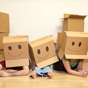 photo of moving boxes on kids heads
