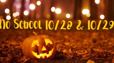 """Image of a pumpkin in a field with lights. Texts reads """"No school 10/28 & 10/29"""""""