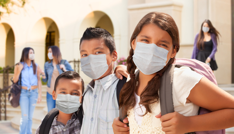 3 children in masks