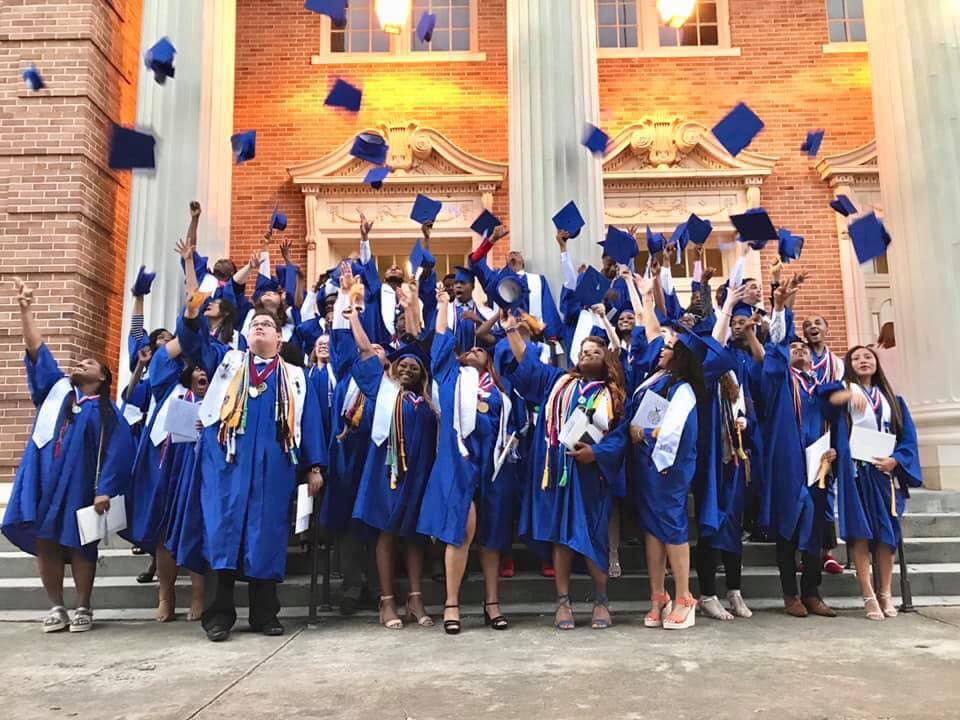 graduating class throwing caps