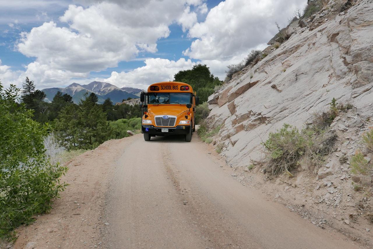 school bus on dirt road