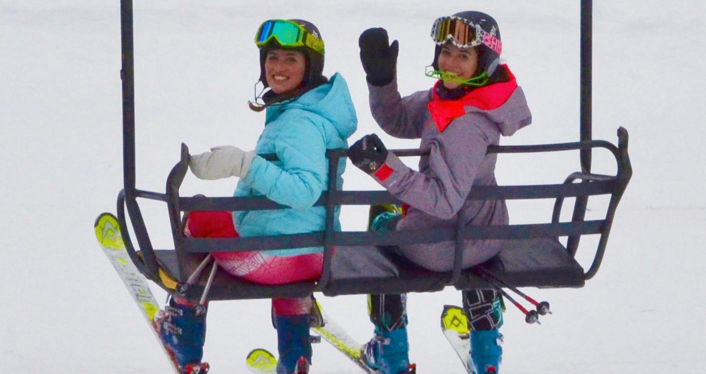 skiers on lift