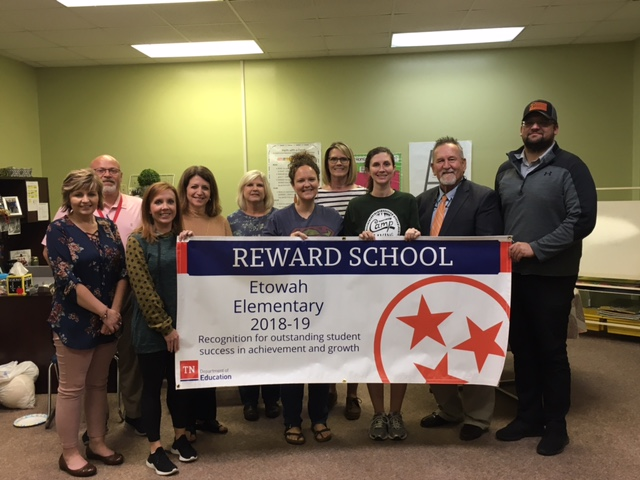 Thankful for our teachers, students, board members, families and community members for working together and achieving Reward School status. The school banner was presented last night at the ECS Board Meeting.